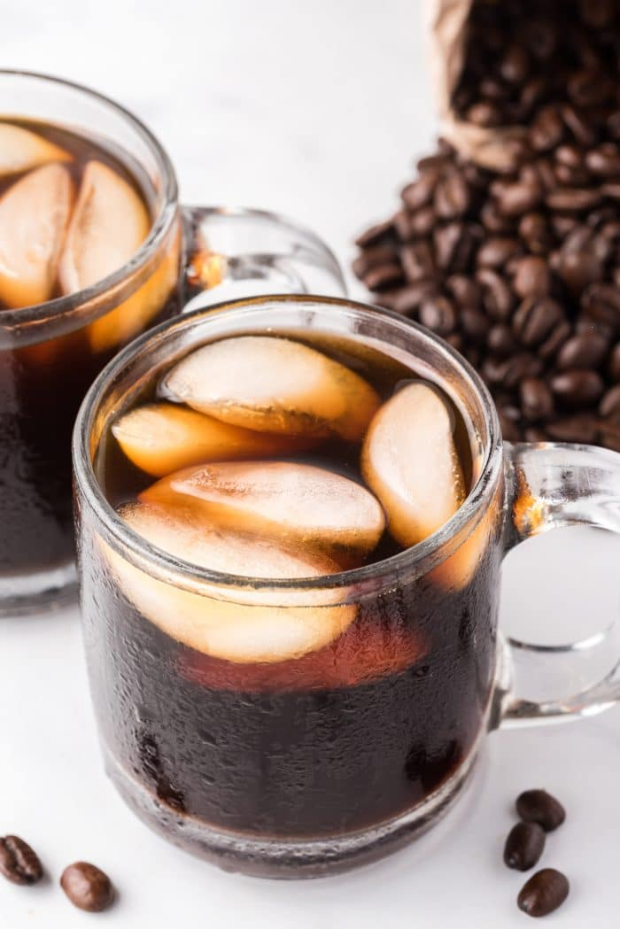 Image of two glasses filled with iced cold brew coffee.