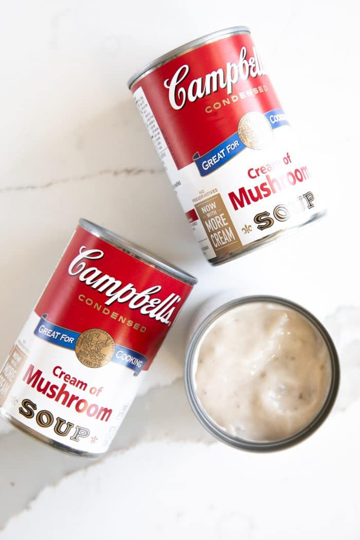 Three cans of Campbell's cream of mushroom soup.