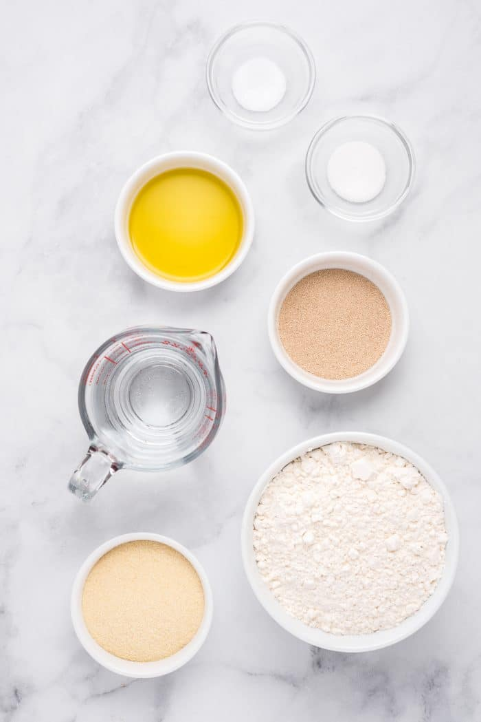 Ingredients needed to make homemade pizza dough.