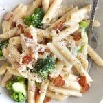 Image of a plate filled with bacon and broccoli pasta penne tossed in a homemade cream sauce.