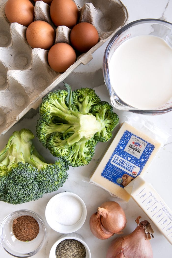 Image of the ingredients needed to make a simple crustless quiche with broccoli.