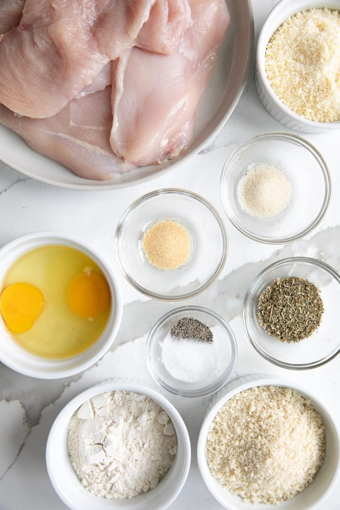 Image of all the ingredients needed to make parmesan crusted chicken breasts.