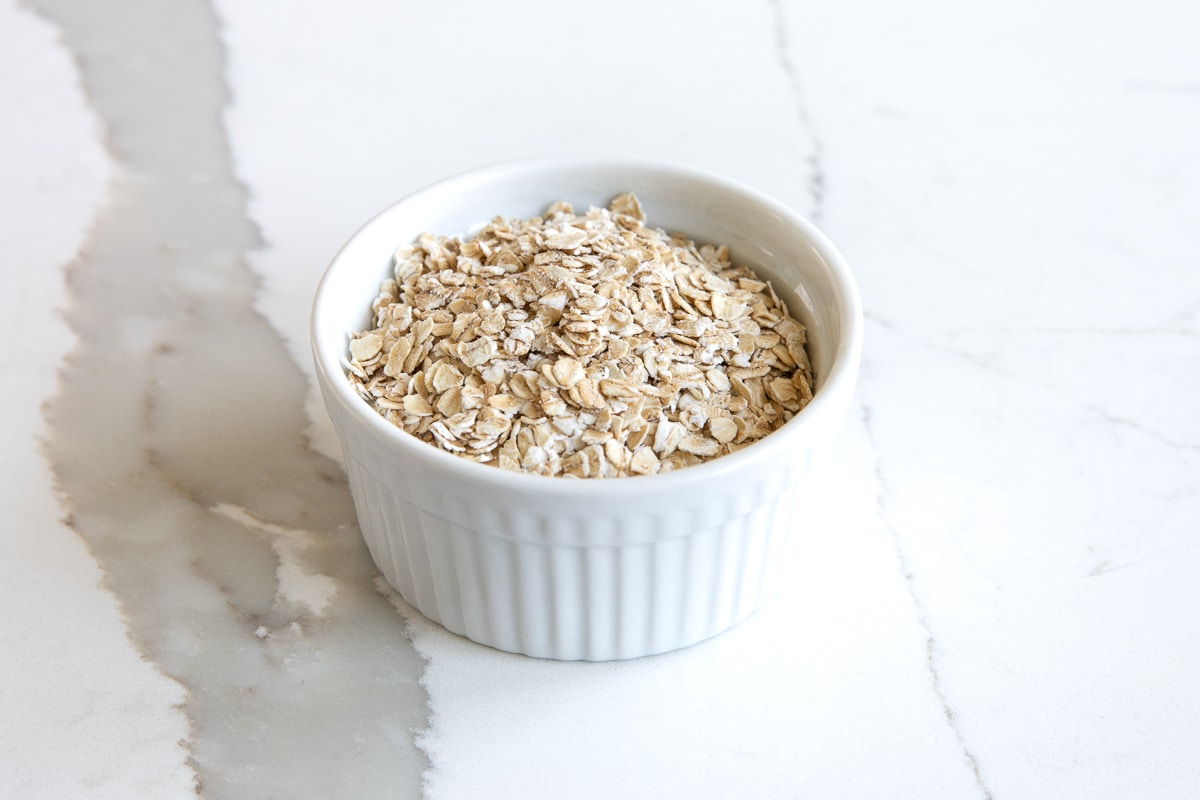 Image of a small white ramekin filled with Instant Oats.