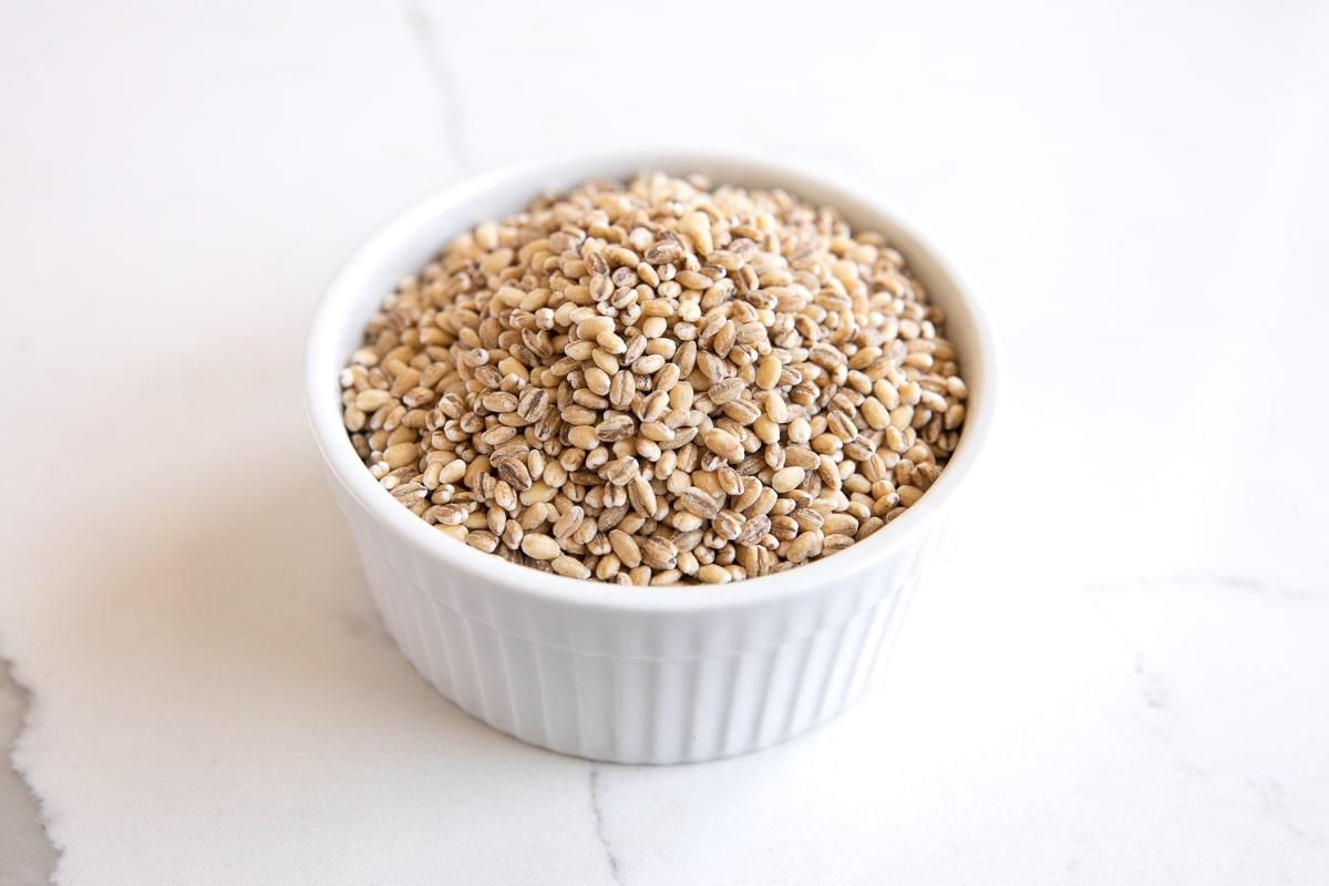 Small white ramekin filled with hulled barley.