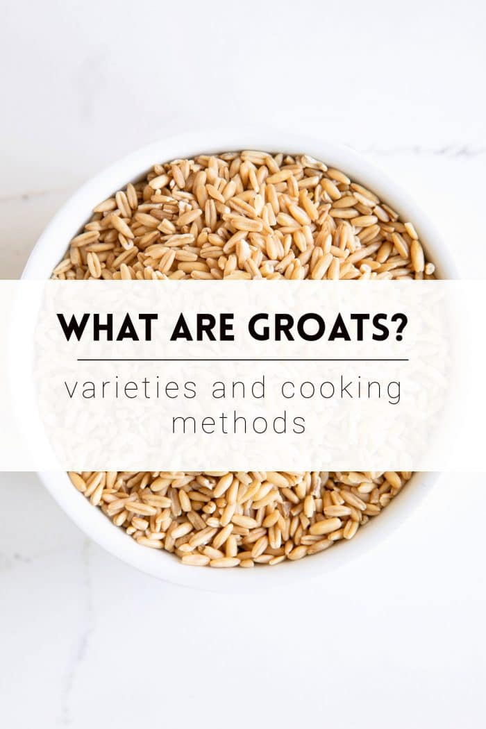"""Image of a small white ramekin filled with oat groats with the text overlay """"What are Groats? Varieties and Cooking Methods""""."""